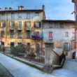 Paved street and old houses in Saluzzo, Italy. — Stock Photo