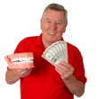 Male senior with teeth modell — Stock Photo