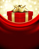 Red gift with gold bow — Stock Vector