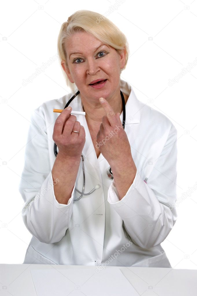 Medical staff member holding a cigarette and shows a hand with the index finger — Stock Photo #6810936