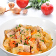 Cabbage soup with carrots, pork meat, potatoes and fresh herbs — Stock Photo