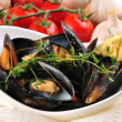 Royalty-Free Stock Photo: Cooked mussels with garlic butter sauce and thyme in a white bow