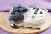 Blueberries with fresh yogurt and a spoon — Stock Photo