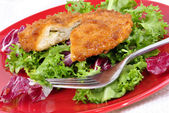Garlic chicken kiev with seasonal salad ready to eat and a fork — Stock Photo