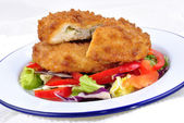 Garlic chicken kiev with mixed leaf salad ready to eat — Stock Photo