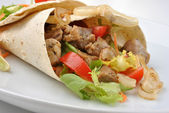 Wrap with grilled pork and some vegetable — Stock Photo