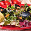 Royalty-Free Stock Photo: Cooked mussels with garlic butter sauce and thyme on fresh salad