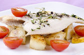 Fresh fried plaice with roasted potatoes and tomatoes — Stock Photo