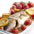 Baked sea bream with tomato, garlic and lemon slices — Stock Photo #7404365