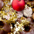 Christmas plate with sweets and golden, festive decoration — Stock Photo