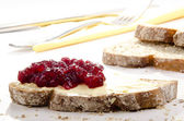 Home made bread spread with cranberry jam — Stock Photo