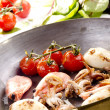 Pan with seafood and grilled tomatoes — Stock Photo