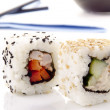 Sushi and soy sauce in the background — Stockfoto #7948965