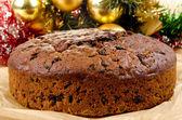 Freshly baked Christmas fruit cake — Stock Photo