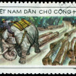 Stock Photo: Vintage postage stamp. Elephant hauling timber.