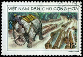 Vintage postage stamp. Elephant hauling timber. — Stock Photo