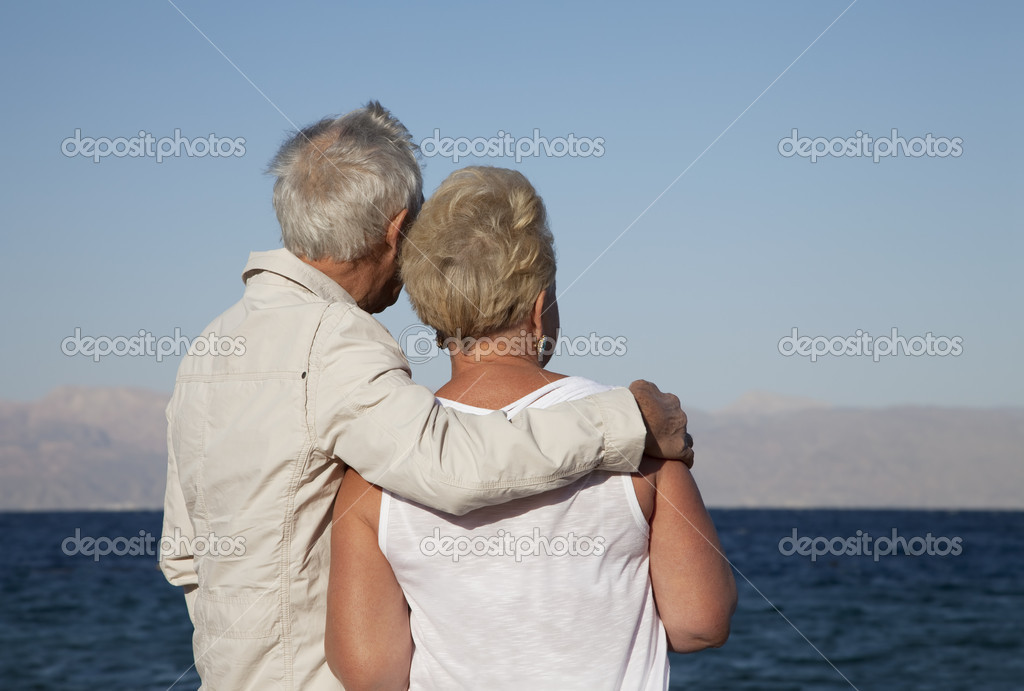 A retired couple lost in their thoughts as they watch the ocean — Stock Photo #7624520