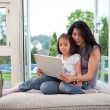 Stock Photo: Mother and daughter with laptop