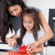 Mother teaches daughter to cook — Stock Photo
