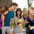 Students Laughing at Phone — Stock Photo #6809421