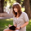 Student with Journal in Park — Foto de Stock