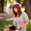 Student with Journal in Park — Stock Photo