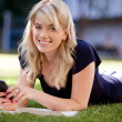 Female University Student Sending Text — Stock Photo