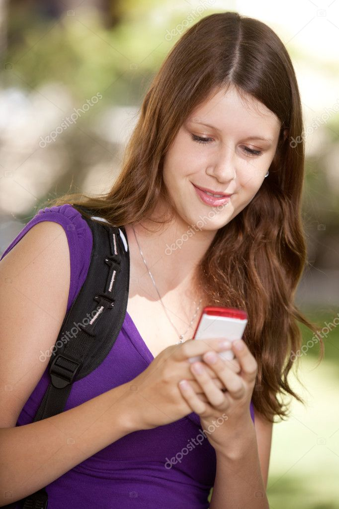 Student looking at cell phone and texting — Stock Photo #6807716