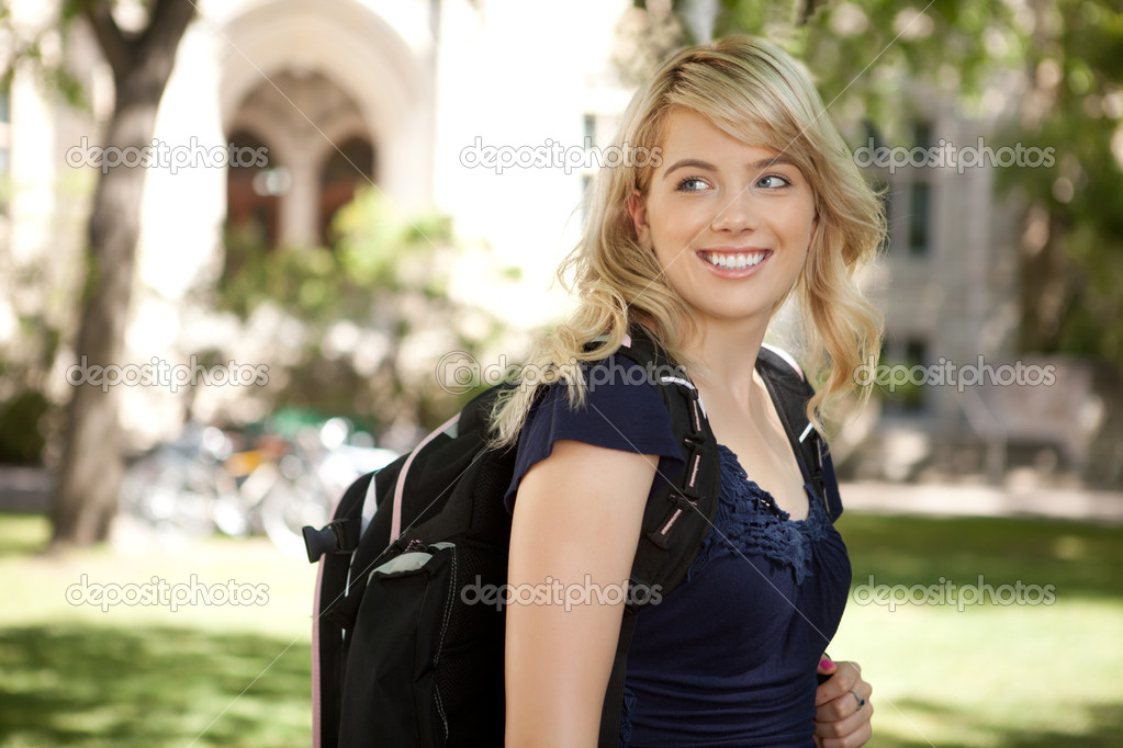 Pretty blond university student looking over shoulder  Stock Photo #6807793