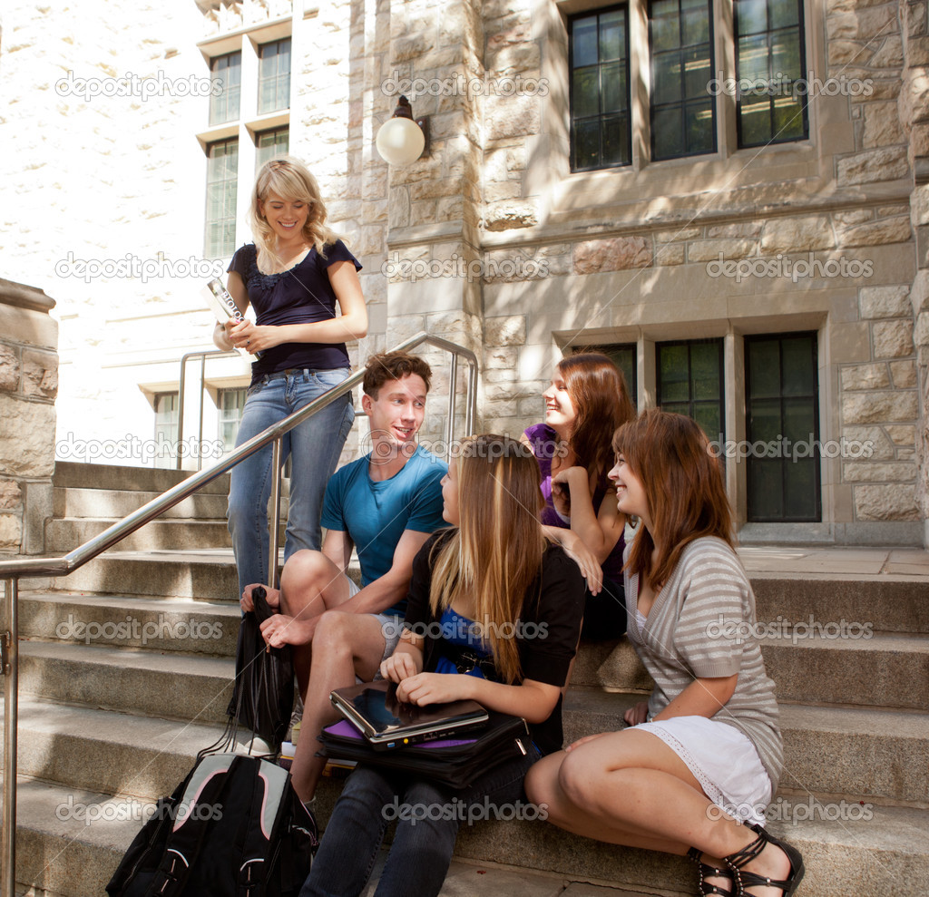 Group of university or college students sitting on steps, visiting and having fun — Stock Photo #6808086