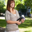 Happy University Student Outdoors - Stock Photo