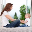 Mother sitting with her child — Stock Photo