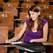 Foto Stock: Happy Student Taking Notes