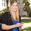College Girl with Phone - Stock Photo