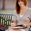 Student Writing in Journal Outdoors — Stock Photo