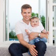 Father and child on couch — Stock Photo