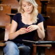 College Girl Writing SMS - Stock Photo