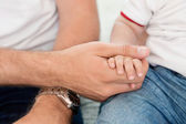 Father holding child's hand — Stock Photo
