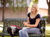 Attractive Student Sending Text Message — Stock Photo