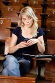 College Girl Writing SMS — Stock Photo
