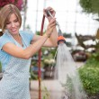 Attractive woman watering the plants — Stock Photo