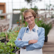 Royalty-Free Stock Photo: Senior Greenhouse Owner