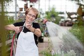 Senior Greenhouse Worker — Stock Photo
