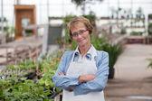 Senior Greenhouse Owner — Stock Photo