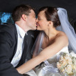 Wedding Couple Kiss in Limo - Stock Photo