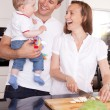 Family Laughing in Kitchen — Stock Photo #6960647