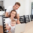 Happy family with laptop — Stok fotoğraf