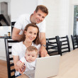 Happy family with laptop — Foto Stock