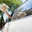 Photo: Bride waving hand holding bouquet