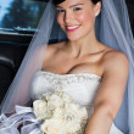 Beautiful Bride in Limo — Stock Photo